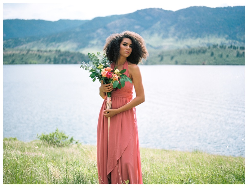 Fashion model, Kaya, in a beautiful coral dress at Horsetooth lake outside of Fort Collins, Colorado. Wedding fashion portrait photography by Sonja Salzburg of Sonja K Photography.