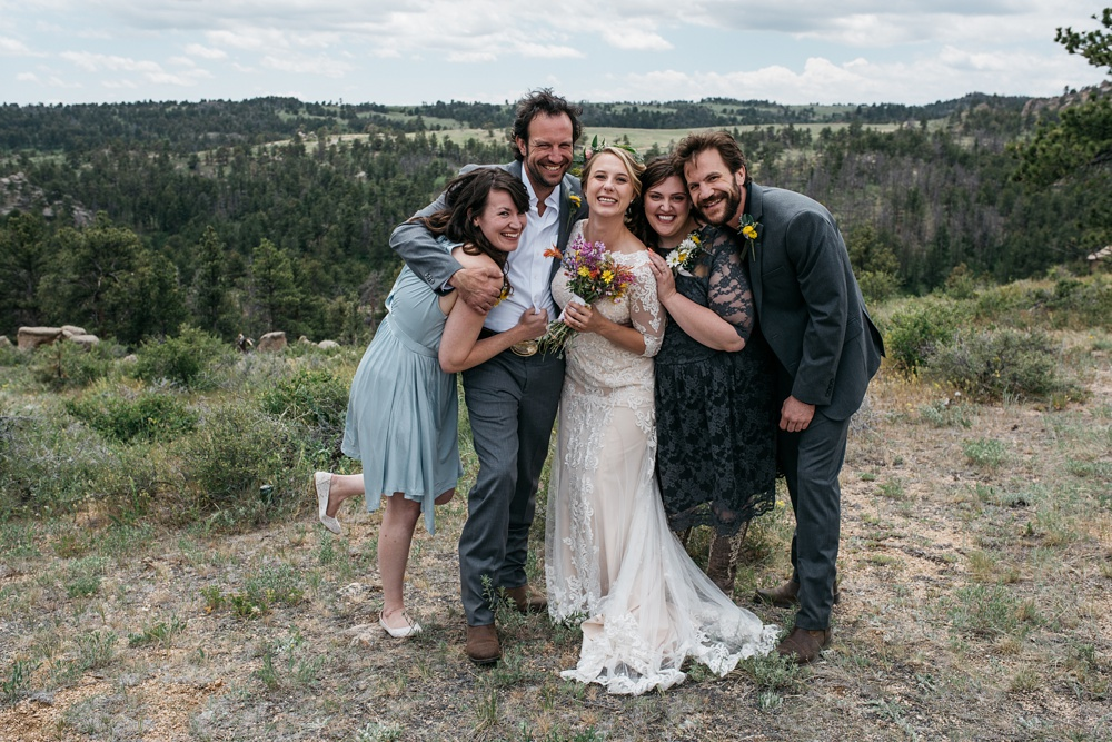 A happy bridal party at an outdoor wedding near Vedauwoo and Curt Gowdy State Park outside of Cheyenne and Laramie, Wyoming. Wedding photography by Sonja Salzburg of Sonja K Photography.