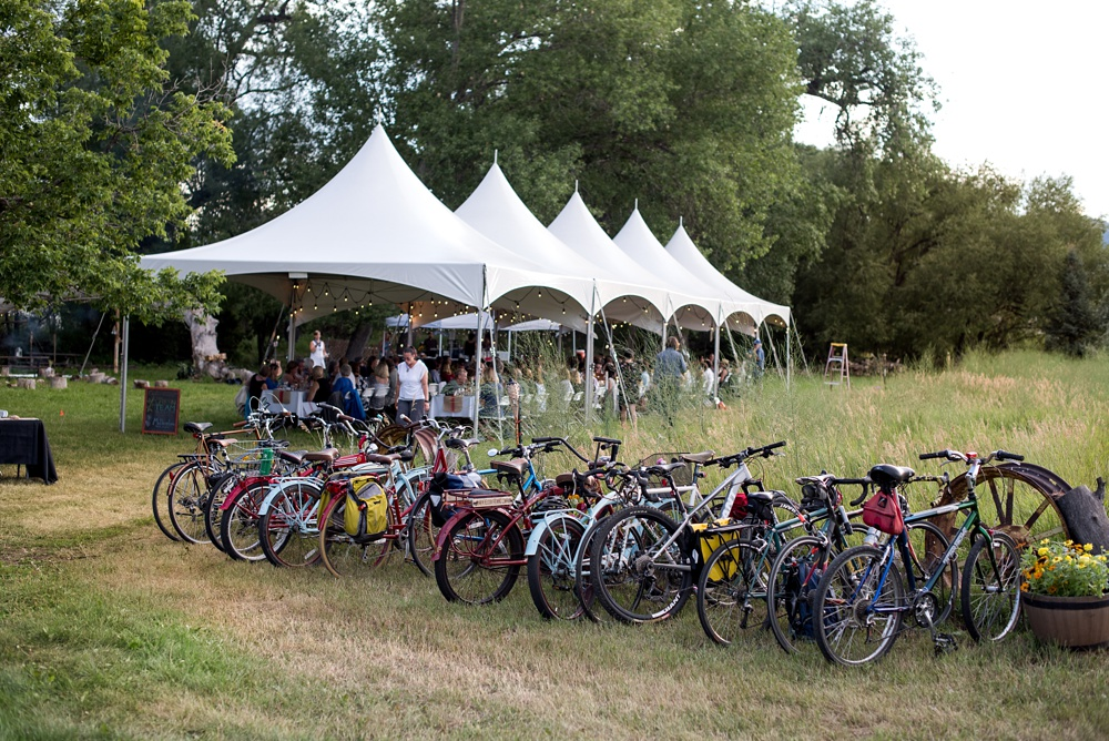 Bike parking in front of the tents at Happy Heart Farm during the Hear of Summer Farm Dinner presented by Fortified Collaborations. Event photography by Sonja Salzburg of Sonja K Photography.