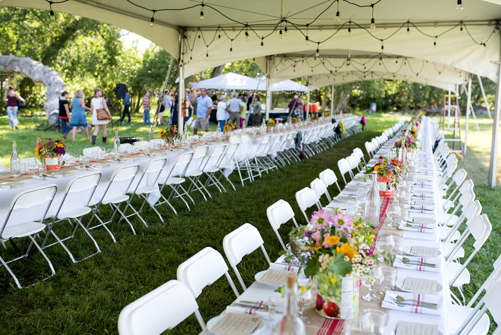 The tables under the tent at Happy Heart Farm for the Heart of Summer Dinner presented by Fortified Collaborations. Event photography by Sonja Salzburg of Sonja K Photography.