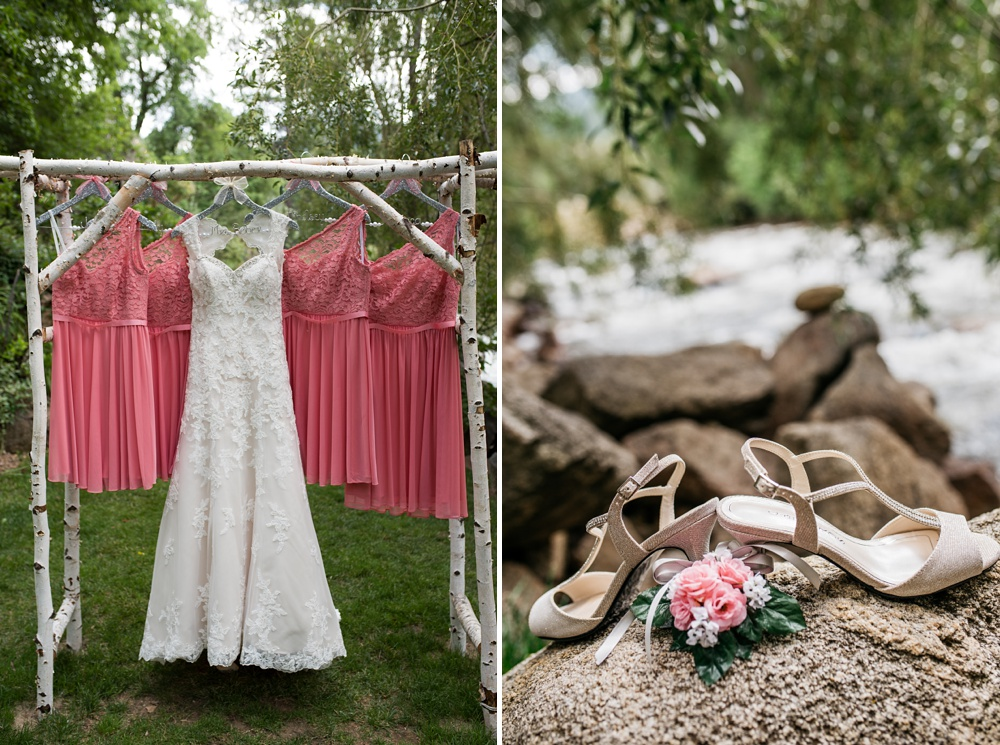 The bride's wedding dress  and shoes with the bridesmaids' dresses at an outdoor wedding at Wedgewood on Boulder Creek outside of Boulder, Colorado. Wedding photography by Sonja Salzburg of Sonja K Photography.