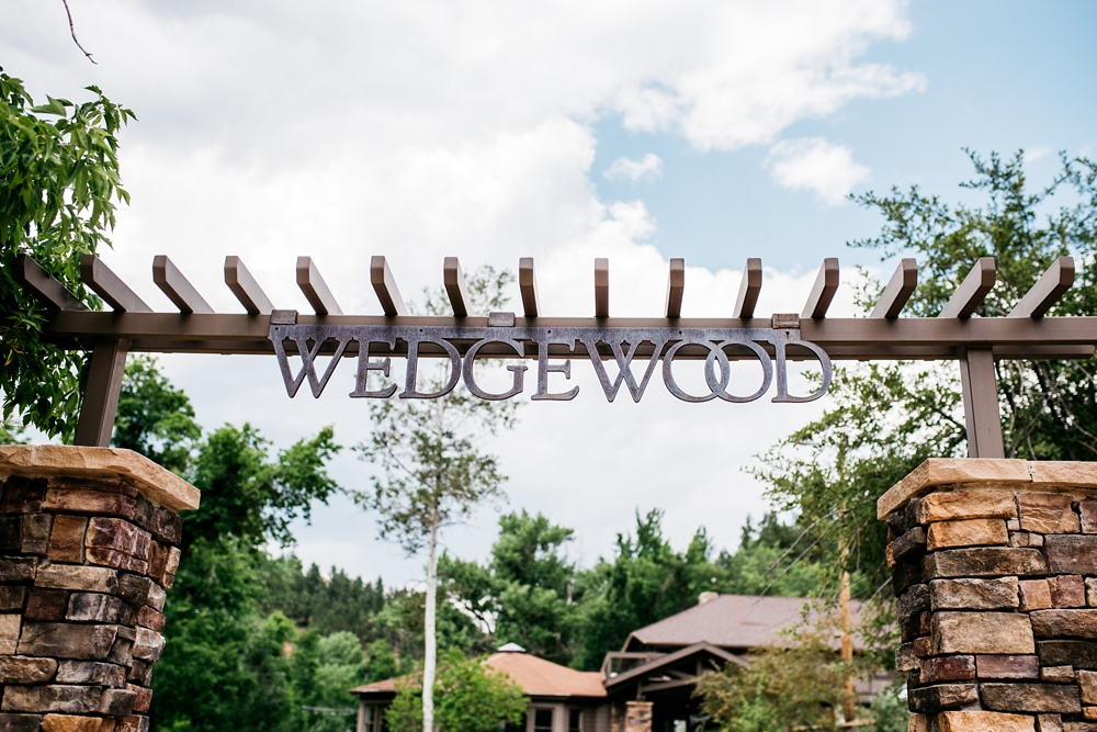 The front gate of an an outdoor wedding at Wedgewood on Boulder Creek in the Boulder Canyon near Boulder, Colorado. Wedding photography by Max Salzburg of Sonja K Photography.