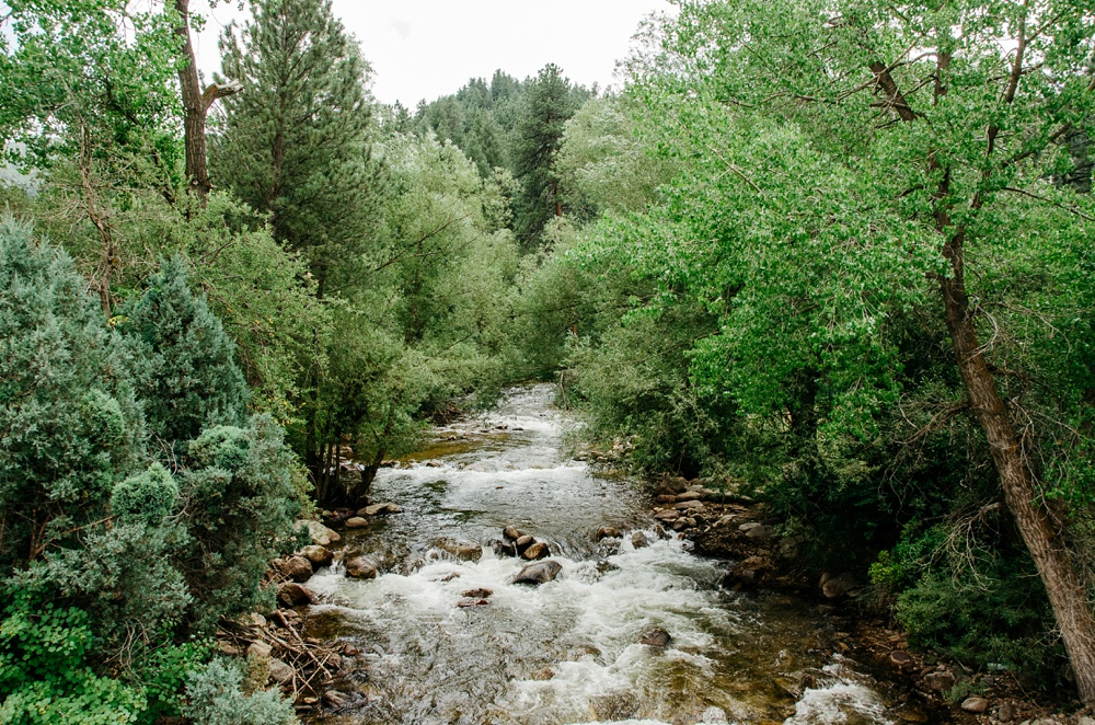 Boulder Creek flows through Wedgewood on Boulder Creek outsides of Boulder, Colorado. Wedding photography by Max Salzburg of Sonja K Photography.