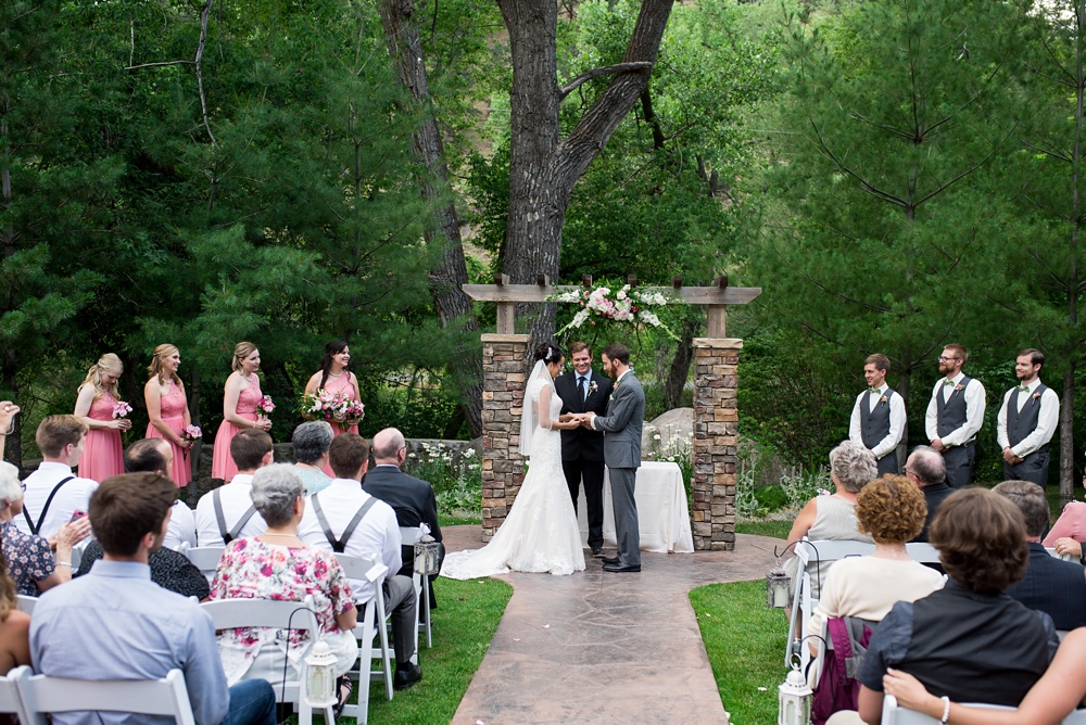 An outdoor wedding ceremony at Wedgewood on Boulder Creek near Boulder, Colorado. Wedding photography by Sonja Salzburg of Sonja K Photography.
