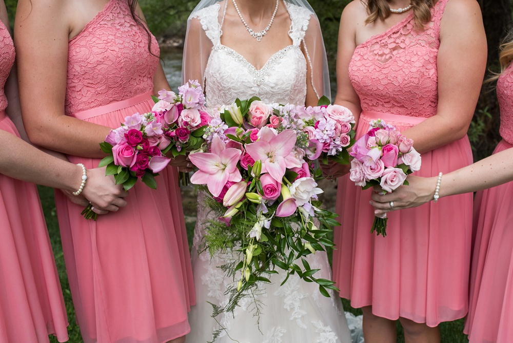 Bright beautiful bouquets by Painted Primrose at an outdoor wedding at Wedgewood on Boulder Creek near Boulder, Colorado. Wedding photography by Sonja Salzburg of Sonja K Photography.