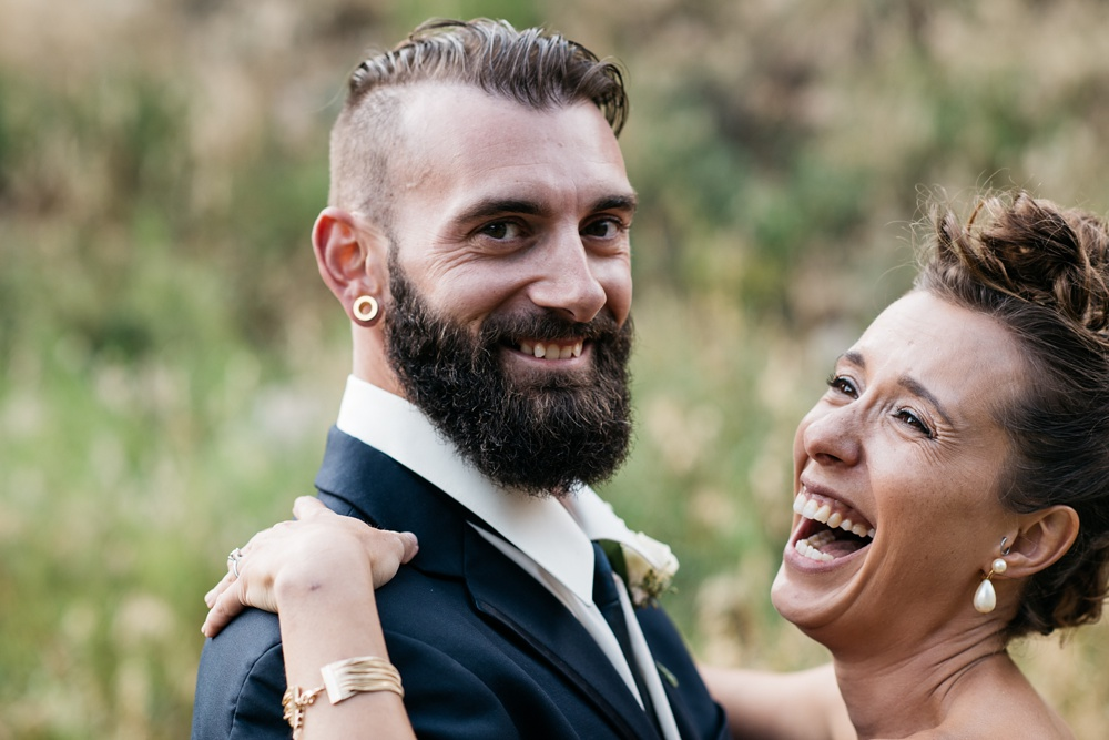 A happy bride and groom on their wedding day at the historic Hamill House in Georgetown, Colorado. Wedding portrait photography by Sonja Salzburg of Sonja K Photography.