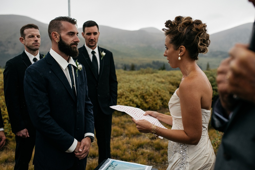 A bride and groom exchange vows in their Jewish wedding on top of Guanella Pass in Colorado. Wedding photography by Sonja Salzburg of Sonja K Photography.