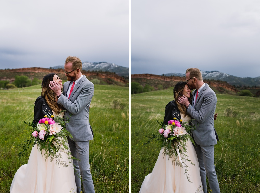 A bride and groom embrace on a cold fall day at Lory State Park outside of Fort Collins, Colorado. Wedding portrait photography by Sonja Salzburg of Sonja K Photography.