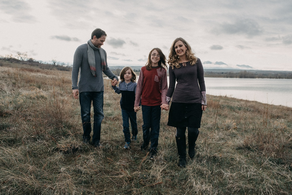 A young family at a session at Standley Lake in Westminster, Colorado. Family portrait photography by Sonja Salzburg of Sonja K Photography.