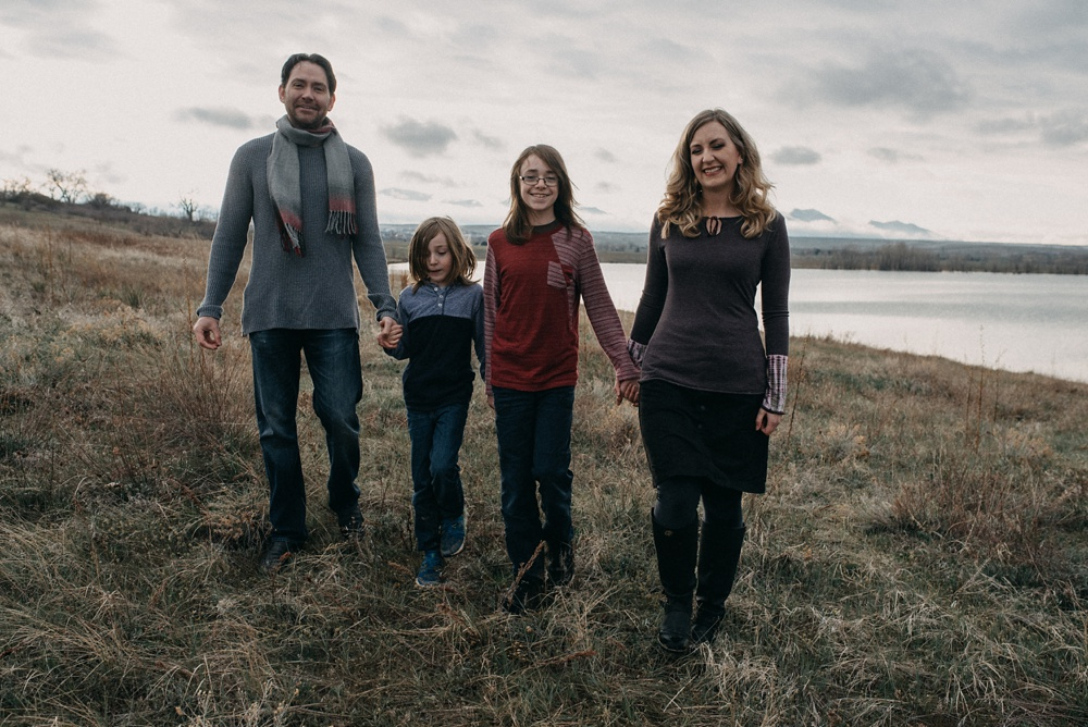 A young family at Stadley Lake in Westminster, Colorado. Engagement and family portrait photography by Sonja Salzburg of Sonja K Photography.