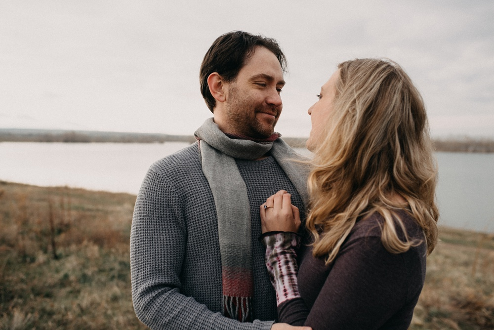 An engaged couple at Stadley Lake in Westminster, Colorado. Engagement and family portrait photography by Sonja Salzburg of Sonja K Photography.