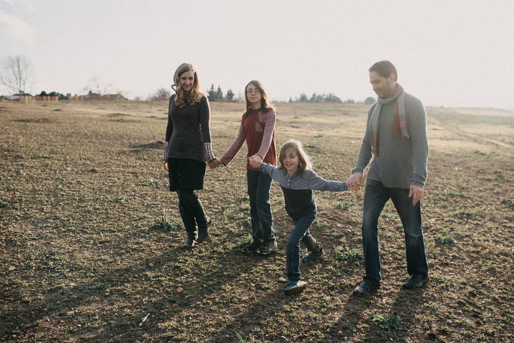 A young family at Standley Lake in Westminster, Colorado. Family and engagement portrait photography by Sonja Salzburg of Sonja K Photography.