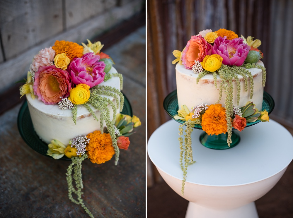 A cake by June Poppies is decorated with flowers from Emily Rose Floral Designs at a styled shoot at Rist Canyon Inn outside of Laporte, Colorado. Wedding styled shoot and food and beverage photography by Sonja Salzburg of Sonja K Photography.