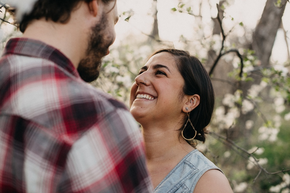 A happy engaged couple at an engagement shoot in Lee Martinez Park in Fort Collins, Colorado. Engagement portrait photography by Sonja Salzburg of Sonja K Photography.