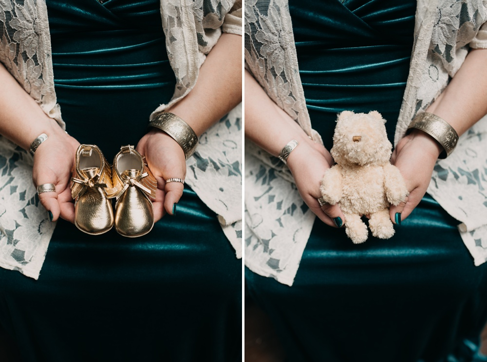 An expectant mother with baby shoes and a stuffed Pooh doll. Maternity portrait photography by Sonja Salzburg of Sonja K Photography.