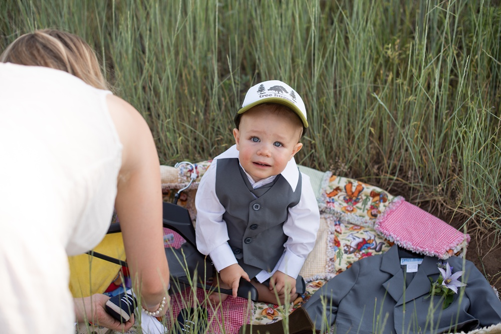 A baby boy gets ready for his parents elopement wedding at Horsetooh Reservoir outside of Fort Collins, Colorado. Elopement wedding photography by Sonja Salzburg of Sonja K Photography. [