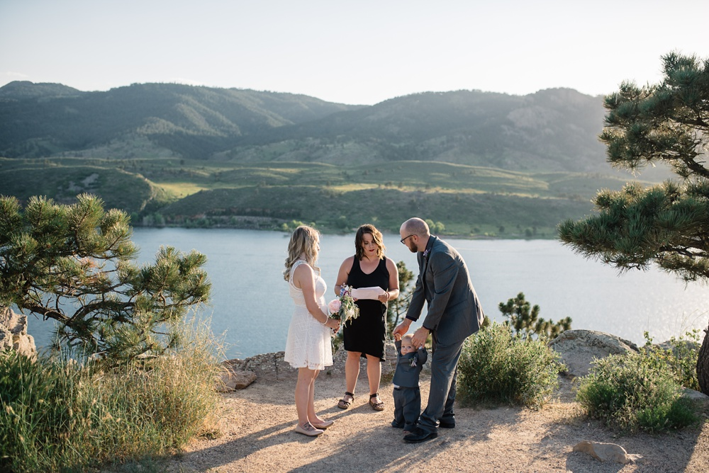 A wedding elopement ceremony at Horsetooth Reservoir outside of Fort Collins, Colorado. Elopement wedding photography by Sonja Salzburg of Sonja K Photography.