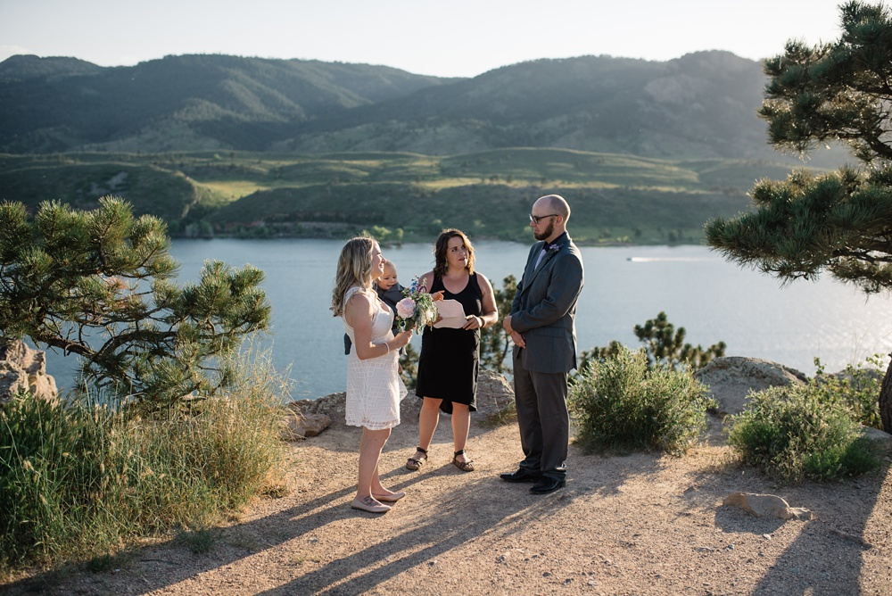 A wedding ceremony at Horsetooth Reservoir outside of Fort Collins, Colorado. Wedding photography by Sonja Salzburg of Sonja K Photography.