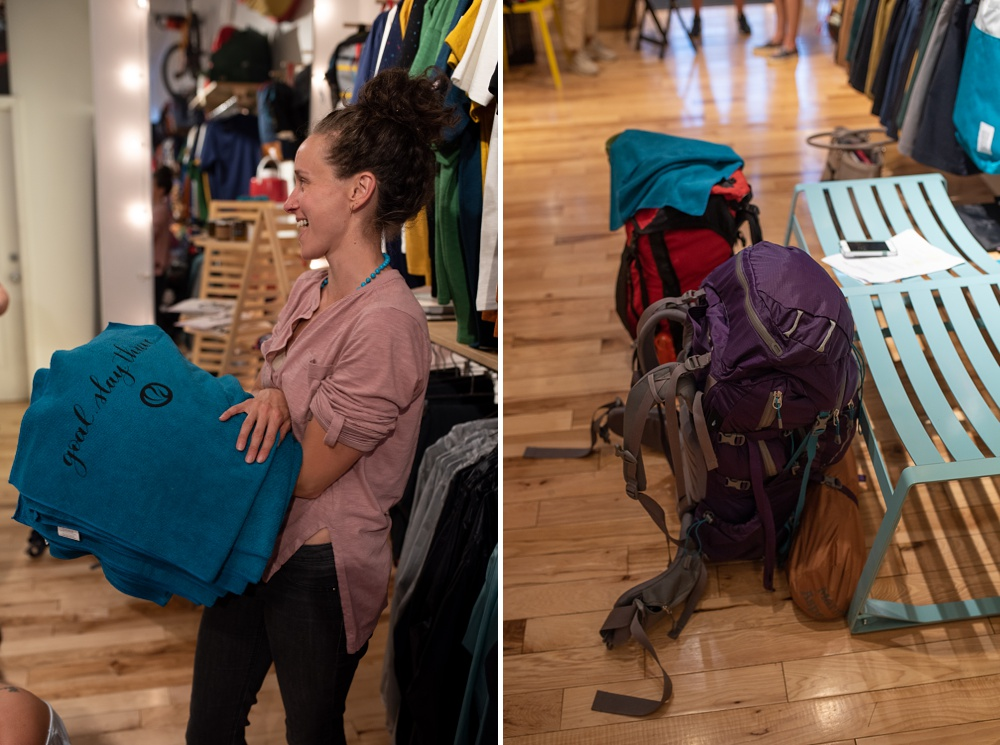 Awesome hiking towels are passed out by Emma of Wellbody Woman and backpacks are packed at Topo Designs in Old Town Fort Collins, Colorado. Corporate event photography by Sonja Salzburg of Sonja K Photography.