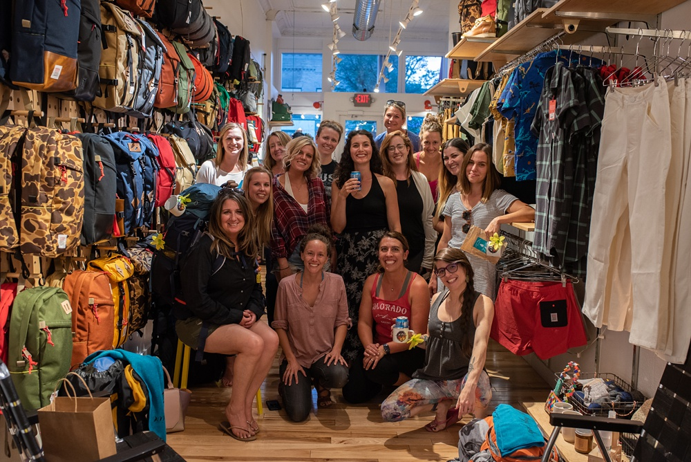 All of the participants at the Wellbody Woman Summer TRIBE Program at Topo Designs in Old Town Fort Collins, Colorado. Corporate event photography by Sonja Salzburg of Sonja K Photography.