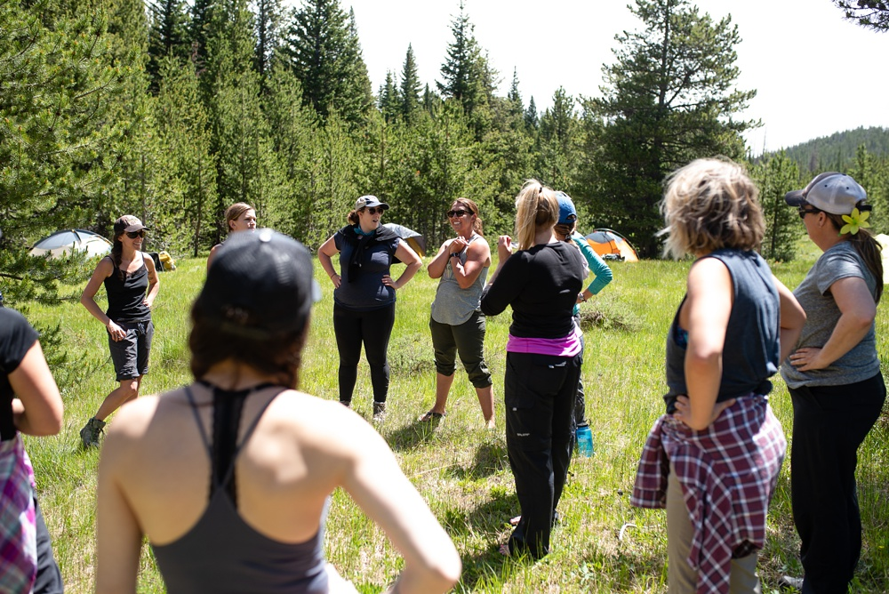 Team building exercises at the Wellbody Woman Summer TRIBE in Indian Peaks Wilderness in Colorado. Outdoor event photography by Sonja Salzburg of Sonja K Photography.