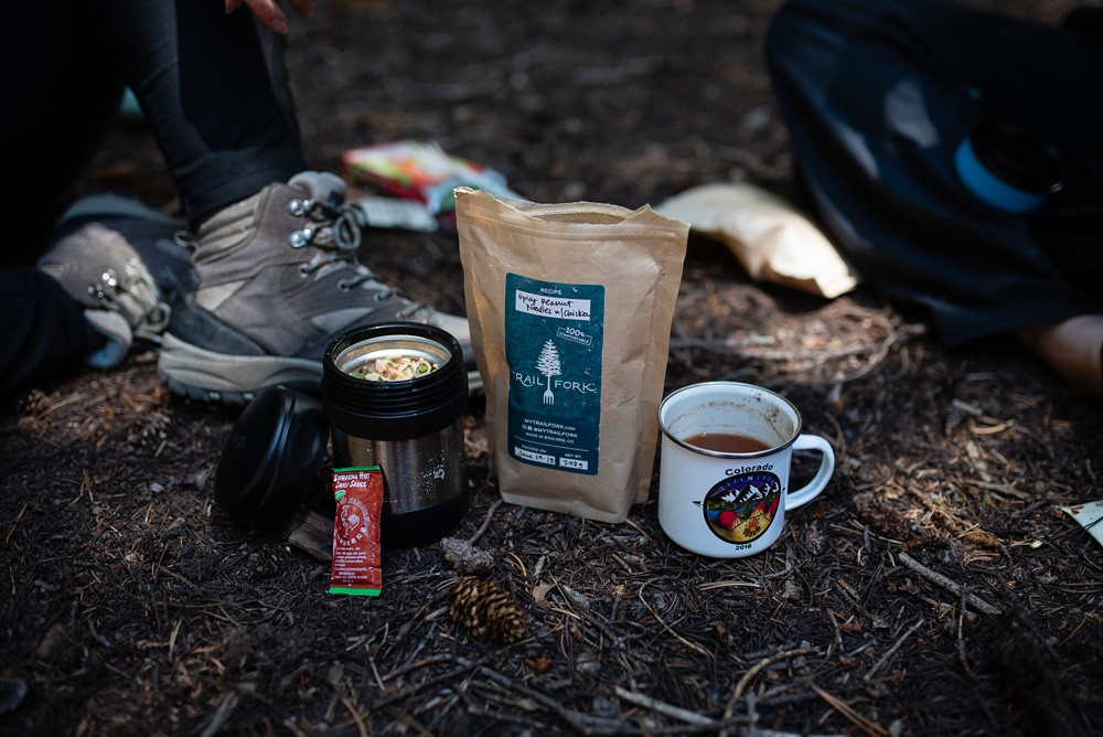 Trailfork breakfast and coffee at the Wellbody Woman Summer TRIBE Program in the Indian Peaks Wilderness. Outdoor food and beverage photography by Sonja Salzburg of Sonja K Photography.