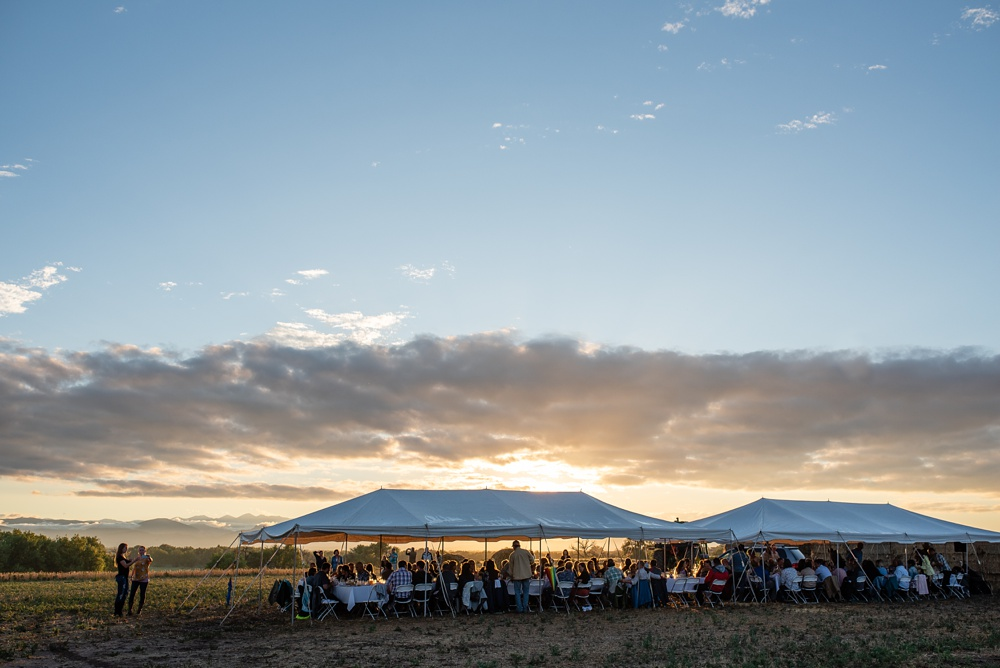 The main tent at sunset at the 2018 Fortified Collaborations Heart of Summer Farm Dinner at Colorado Stock and Grain Farms in Colorado. Event and food and beverage photography by Sonja Salzburg of Sonja K Photography.