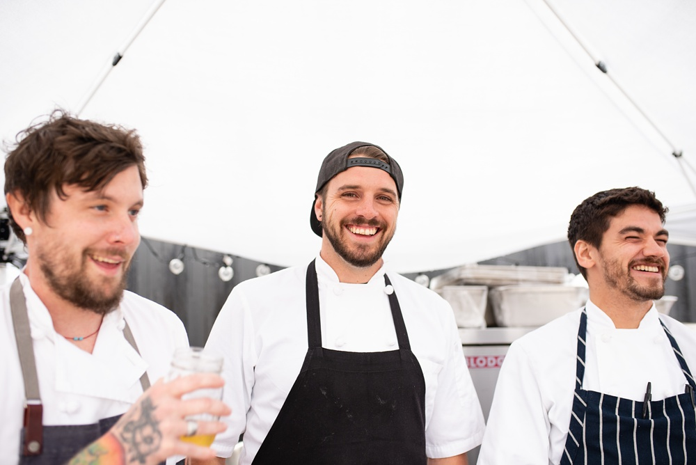 The chefs of Locality at the Fortified Collaborations Heart of Summer Farm Dinner at Colorado Stock and Grain in Colorado. Event portrait and food and beverage photography by Sonja Salzburg of Sonja K Photography.