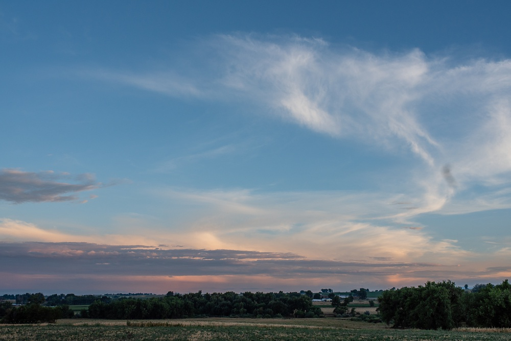 The sunset at the 2018 Fortified Collaborations Heart of Summer Farm Dinner at Colorado Stock and Grain Farm. Event and Food and Beverage photography by Sonja Salzburg of Sonja K Photography.