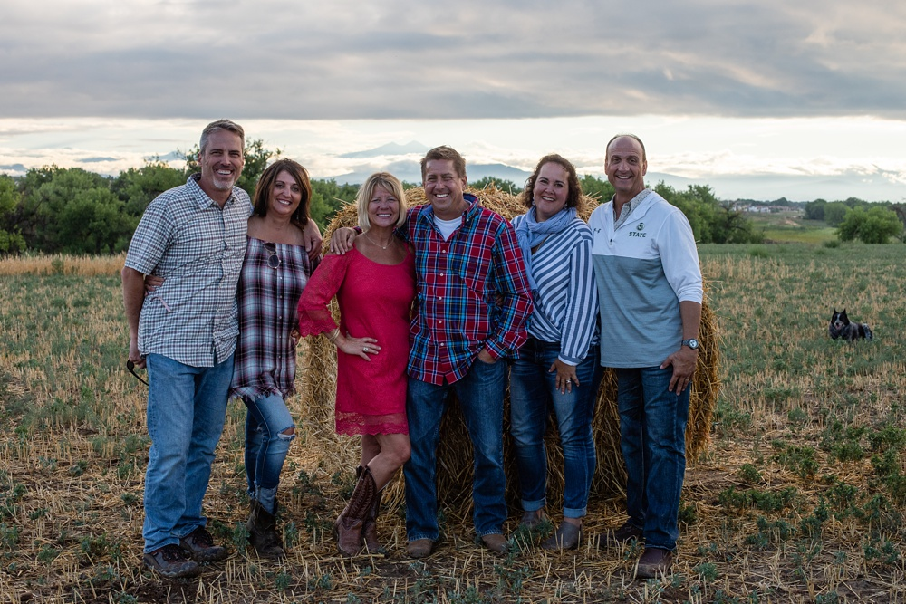 A group of guests at the Fortified Collaborations Heart of Summer Farm Dinner at Colorado Stock and Grain Farm in Colorado. Event portrait and food and beverage photography by Sonja Salzburg of Sonja K Photography.