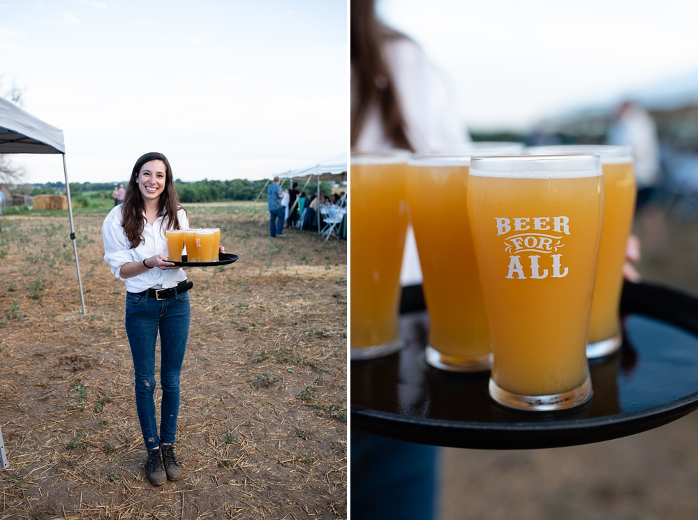 A server brings around beer by Verboten Brewing at the Fortified Collaborations Heart of Summer Farm Dinner at Colorado Stock and Grain Farm in Colorado. Event and Food and Beverage photography by Sonja Salzburg of Sonja K Photography.