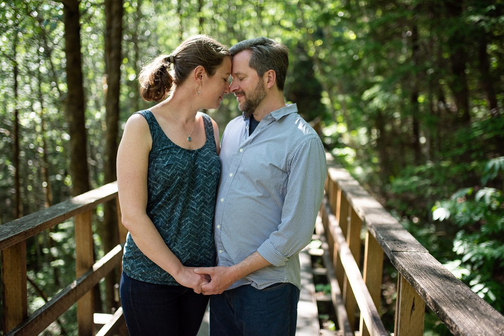 A young engaged couple on the Flume Trail outside of Juneau, Alaska. Engagement portrait photography by Sonja Salzburg of Sonja K Photography.