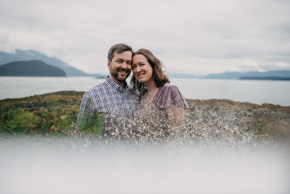 A fine art portrait of an engaged couple at Pearl Harbor near Juneau, Alaska. Engagement portrait photography by Sonja Salzburg of Sonja K Photography.