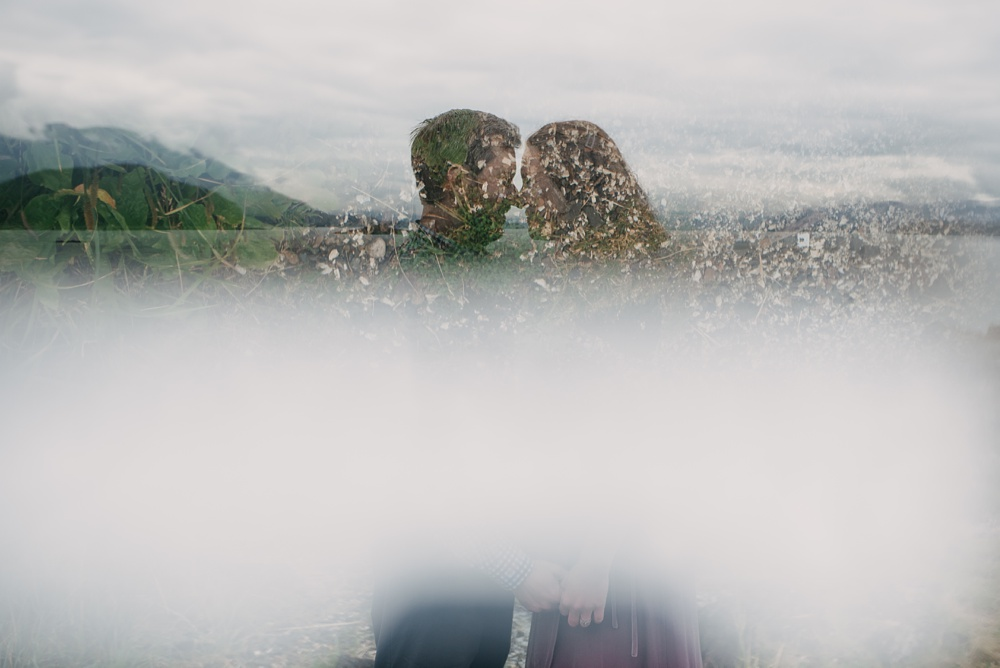 An artistic photo of an engaged couple at a session at the Jensen-Olson Arboretum outside of Juneau, Alaska. Engagement portrait photography by Sonja Salzburg of Sonja K Photography.