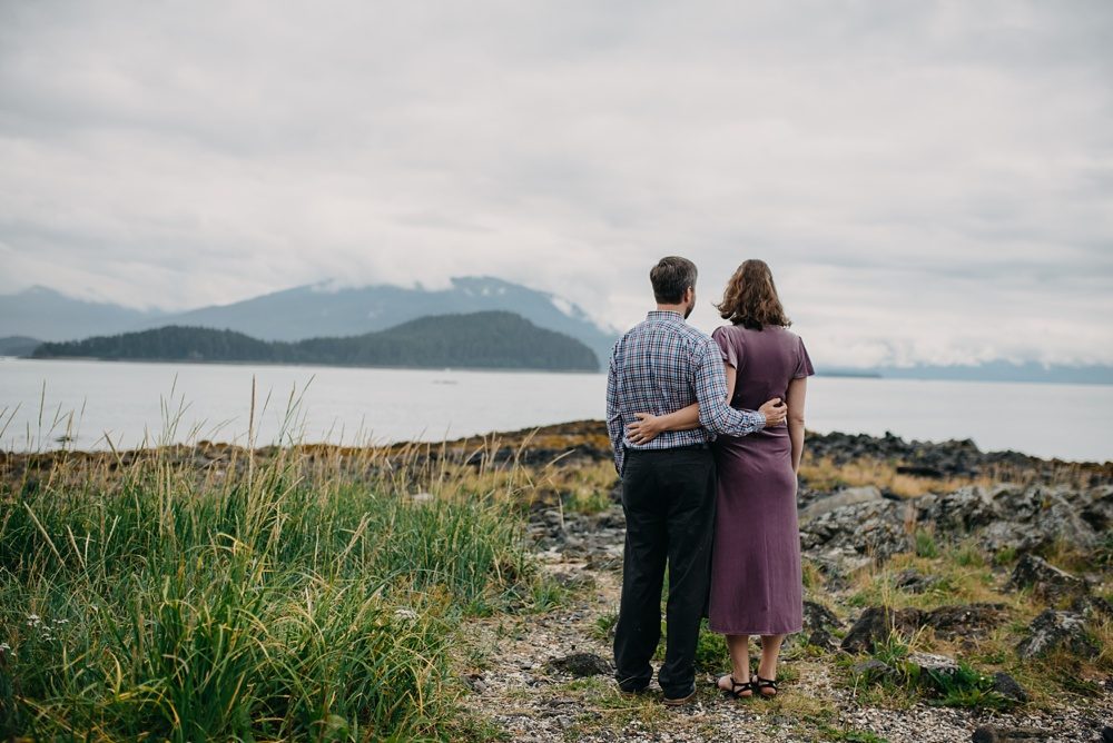 An engaged couple at Pearl Harbor outside of the Jensen-Olson Arboretum near Juneau, Alaska. Engagement portrait photography by Sonja Salzburg of Sonja K Photography.
