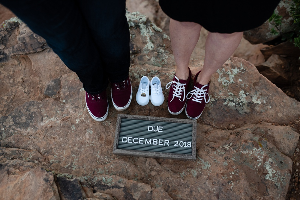 Baby shoes at Duncan Ridge outside of Fort Collins, Colorado. Maternity portrait photography by Sonja Salzburg of Sonja K Photography.