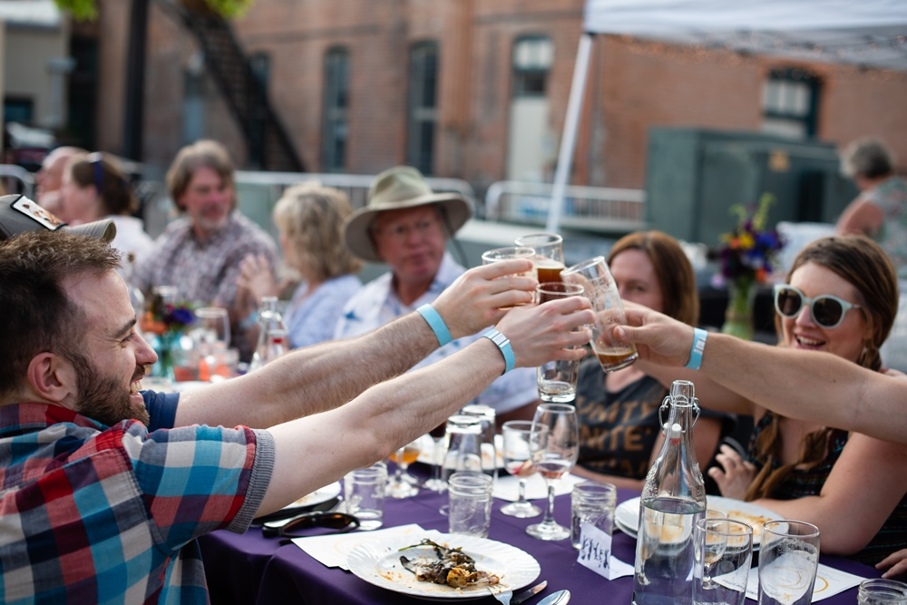 Cheers to the Fortified Collaborations Second Sunday Supper Farm Dinner in Montezuma Fuller Alley in Old Town Fort Collins, Colorado. Event and Food and Beverage photography by Sonja Salzburg of Sonja K Photography.