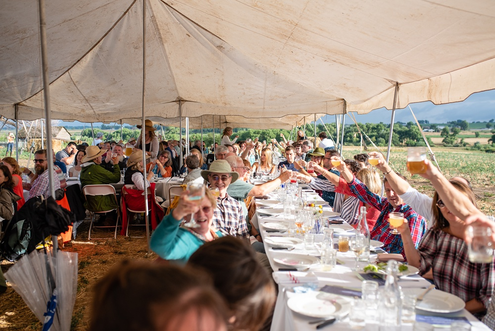 Cheers to the Fortified Collaborations Heart of Summer Farm Dinner at Colorado Stock and Grain Farm in Colorado. Event and food and beverage photography by Sonja Salzburg of Sonja K Photography.