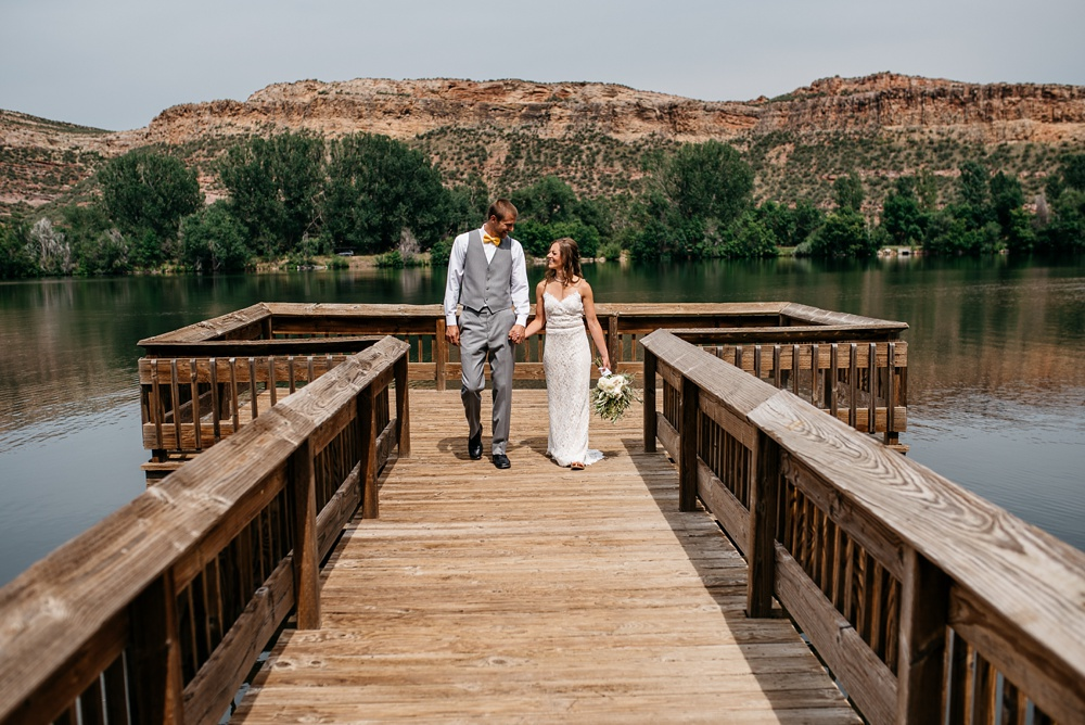 A married couple on their wedding day at Watson Lake outside of Laporte, Colorado. Wedding portrait photography by Sonja Salzburg of Sonja K Photography.