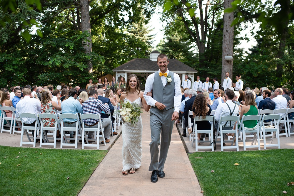 The bride and groom after their wedding ceremony at the Tapestry House in Laporte, Colorado. Wedding photography by Sonja Salzburg of Sonja K Photography.