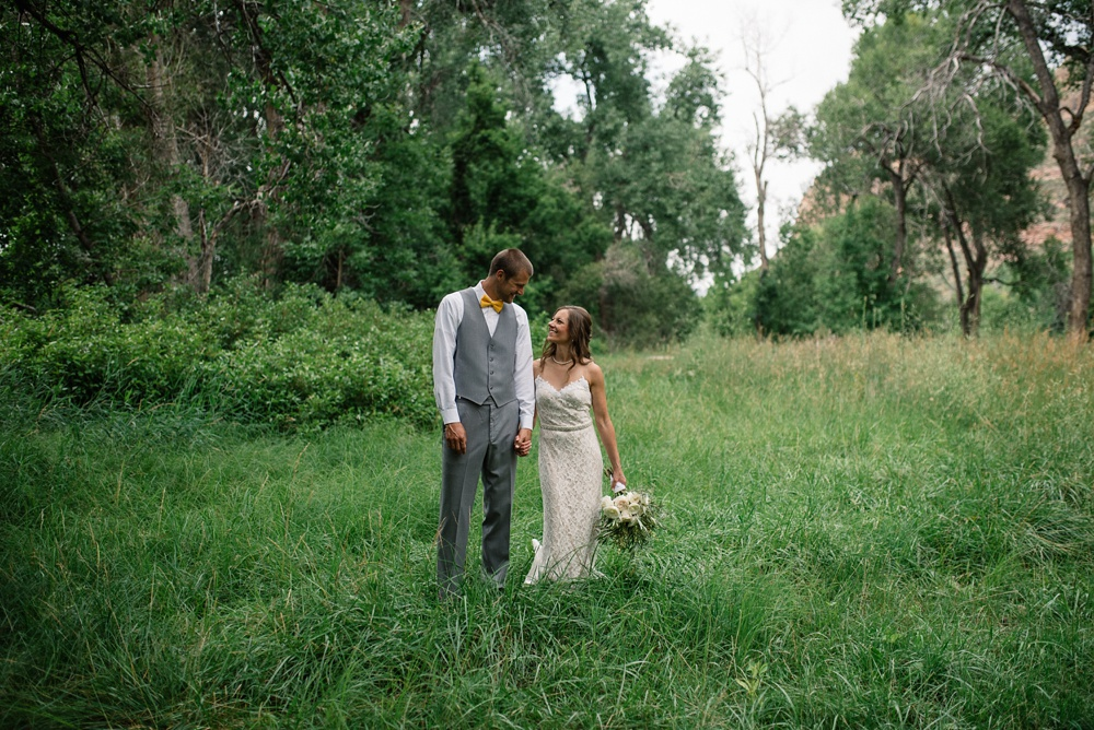 A couple on their wedding day near Watson Lake outside of Fort Collins, Colorado. Wedding portrait photography by Sonja Salzburg of Sonja K Photography.