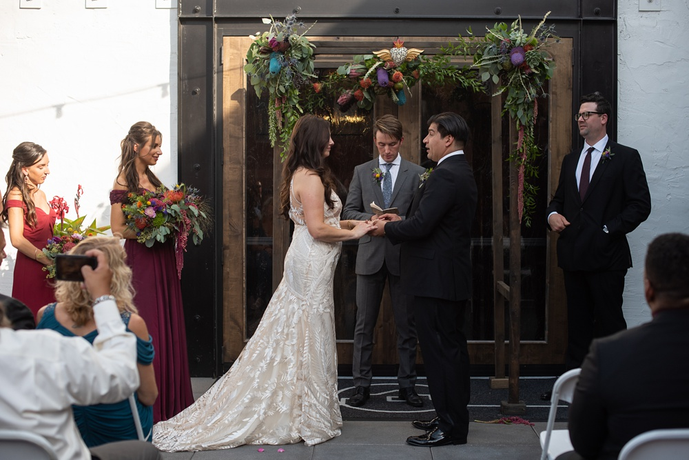 A wedding ceremony at Ginger and Baker in Fort Collins, Colorado. Wedding photography by Sonja Salzburg of Sonja K Photography.