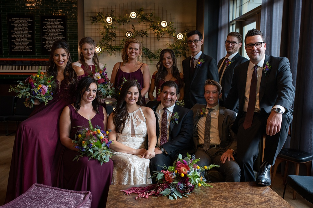 A wedding party in the Magic Rat inside the Elizabeth Hotel in Fort Collins, Colorado. Wedding portrait photography by Sonja Salzburg of Sonja K Photography.