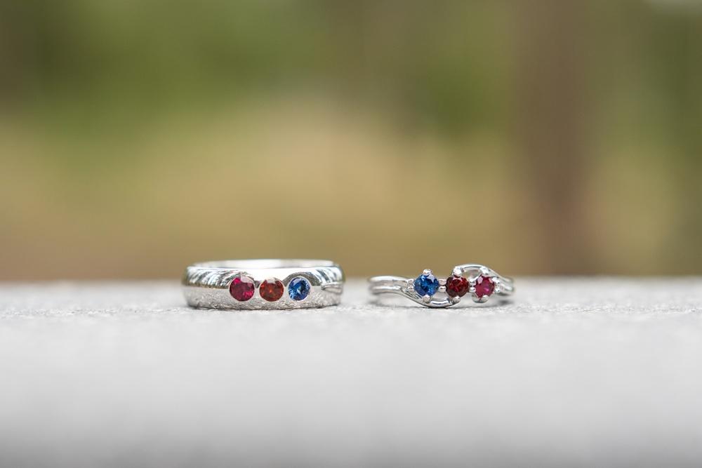 Wedding rings at a lesbian wedding near Fraser, Colorado. Gay wedding photography by Sonja Salzburg of Sonja K Photography.