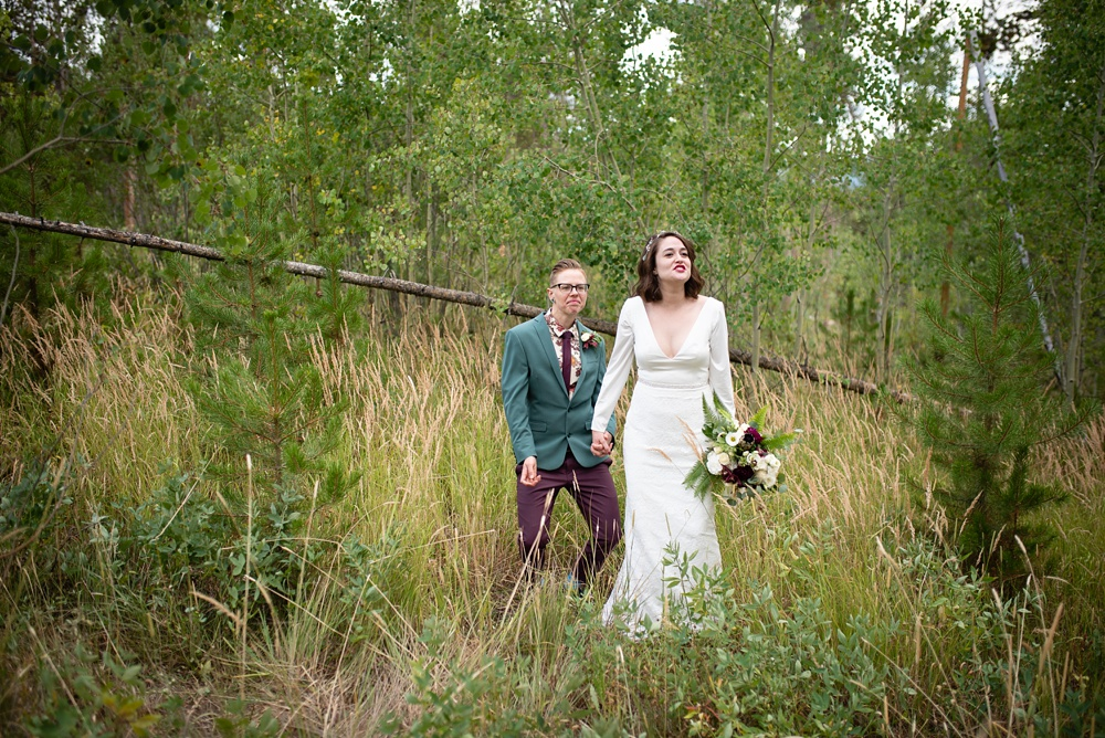 A married lesbian couple on their wedding day near Fraser, Colorado. Gay wedding photography by Sonja Salzburg of Sonja K Photography.