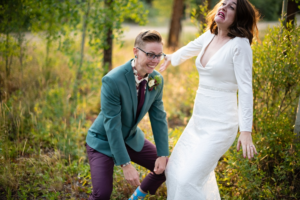 A newly married lesbian couple on their wedding day in Fraser, Colorado. Gay wedding photography by Sonja Salzburg of Sonja K Photography.