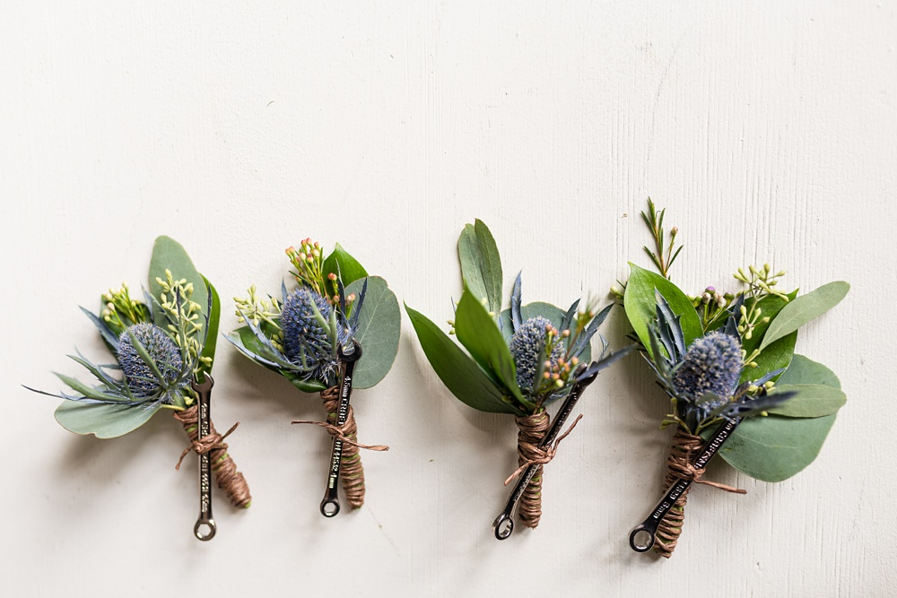 cute boutonnieres for groomsmen and the groom with car wrenches on them for a Colorado wedding at Wedgwood on Boulder Creek