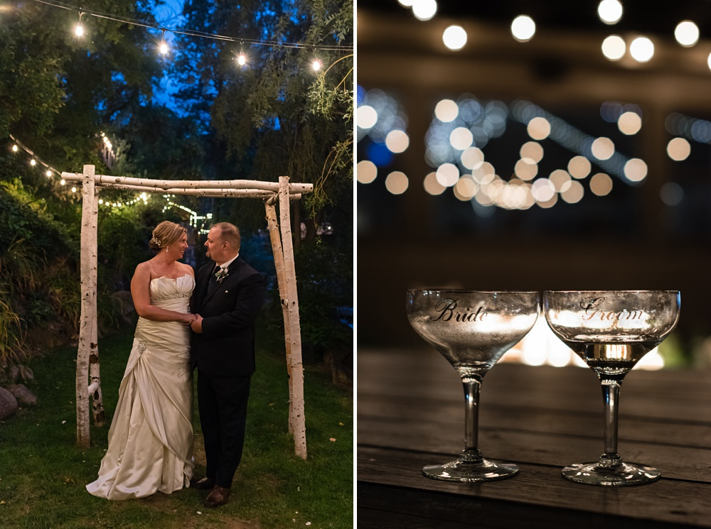 a Colorado couple outdoors on their wedding day with twinkle lights and their toasting champagne flutes - photography by Sonja Salzburg of Sonja K Photography