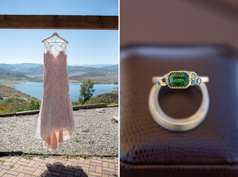 A classic wedding dress hangs in front of a view over Steamboat Springs, Colorado, next to a beautiful gold wedding and engagement ring set at Bella Vista Estate. Photography by Sonja Salzburg of Sonja K Photography