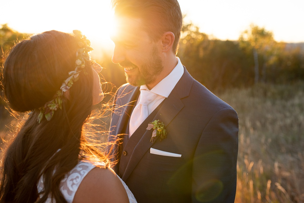 A bride and a groom during the sunset on their wedding day in Steamboat Springs, Colorado at Bella Vista Estate. Photography by Sonja Salzburg of Sonja K Photography